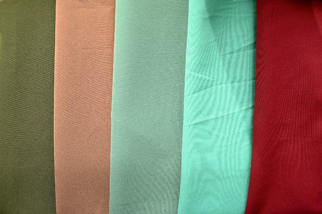 Ткань меланж: что это такое, состав и описание трикотажа, свойства и применение, виды, тянется или нет, достоинства и недостатки