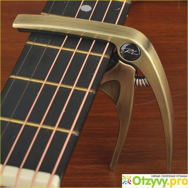 Каподастр для гитары: что нужно знать и как выбрать?