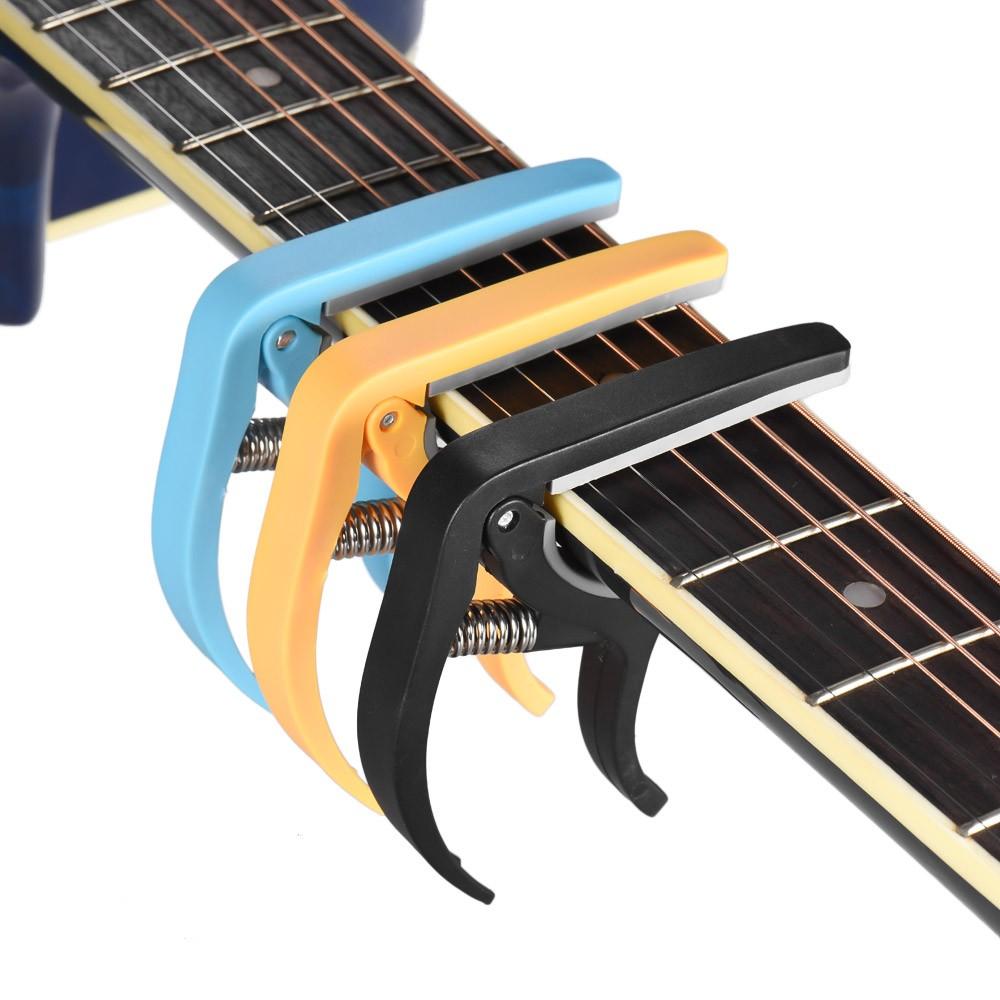 Каподастр для гитары – всё, что нужно знать